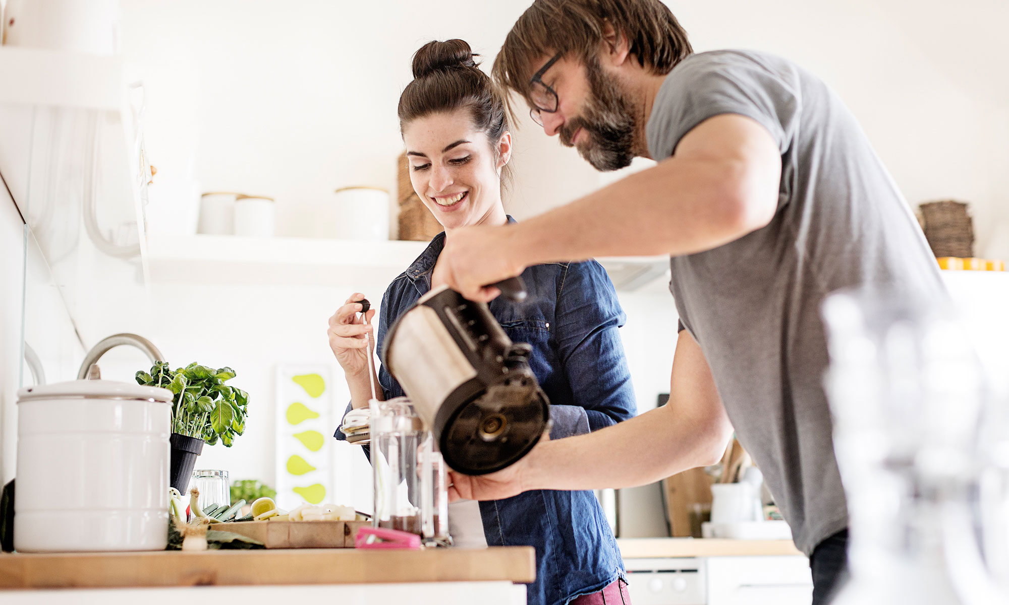 Couple making coffee at home.